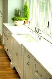 marble laminate kitchen with white cabinets calcutta calacatta countertop
