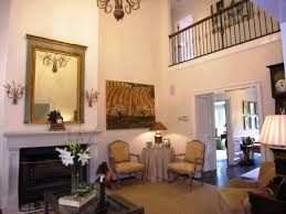 Decorating High Ceiling Walls Living Room With High Ceiling And Fireplace