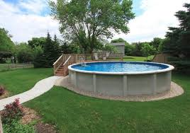 above ground pool with partial deck and sidewalk backyard landscaping
