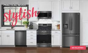 white kitchen cabinets with black stainless steel appliances luxury