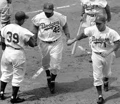 the breakthrough in jackie robinson proved he belonged roy campanella and pee wee reese welcome jackie robinson at home plate after his first inning