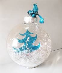 paper tree with snow in clear glass ornament