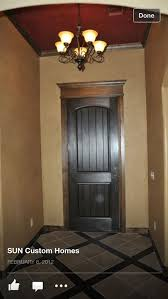 black door dark wood trim and tanish walls a possibility i would think