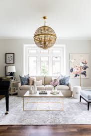 beige couches living room design. beige couch with marble coffee table and gold chandelier via studio mcgee couches living room design