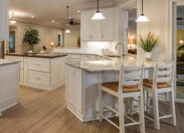 not one but two peninsulas and an island in this spacious kitchen