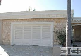 coastal garage doorsCoastal Custom Garage Doors Designed in a Louvered Shutter Style