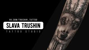 Slava Trushin Tattoo волк и лес на руке