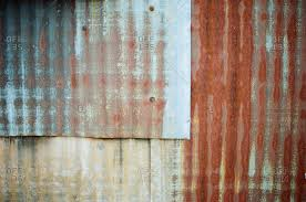 overlapping sheets of rusted corrugated tin overlapping sheets of rusted corrugated tin