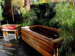 rustic wood outdoor bathtub