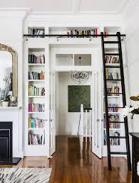 Built In Bookshelf Ideas Built In White Bookcase Shelves Around Doorway French Doors