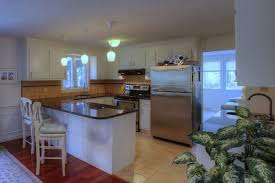 a flush mount light in the center of the kitchen can work in concert with