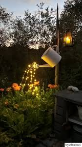 cheap outdoor lighting ideas. Watering Can With Fairy Lights Cheap Outdoor Lighting Ideas O