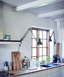 Ikea lighting ideas Ceiling White Kitchen With Two Work Lamps Installed On The Wall Ikea Lighting Ideas From Homes Around The World Ikea