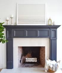 the fireplace paint color is benjamin moore midnight oil art is patagonian winter print from
