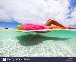 Underwater view of nice caucasian woman enjoying the summer ...