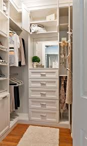large wardrobe with racks and shoe shelves drawers and a small mirror