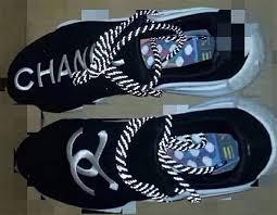 chanel x pharrell adidas. source: wwd chanel x pharrell adidas a