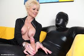Milf with the naked boobs Nikki Sixxx is playing sexily with the.
