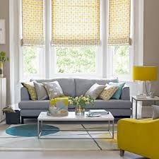 warm grey brown living room with yellow accents