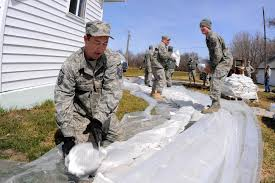 u s department of defense photo essay air force master sgt david bush places sandbags into position as he and members of