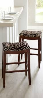 add some safari chic to your décor with our serengeti stools these leopard and zebra