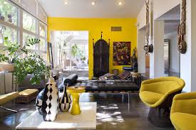 Eclectic concrete floor living room idea in Portland with yellow walls