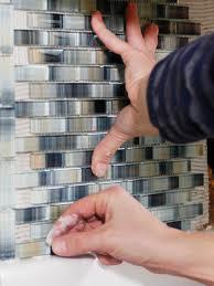 install tiles for the backsplash