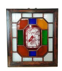 a manchurian stained glass panel on a wood frame late 19th century fl