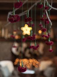 how to make a hanging branch chandelier for your holiday party s decorating design blog