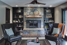 baroque leather wingback chairin living room rustic with killer modern recliners next to graceful black window trim alongside aesthetic slate blue and blue dark trendy living room