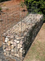 The filled lower gabion wall ...