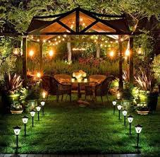 outdoor garden lighting ideas. Rattan Chairs Decoration And Outdoor Dining Table With Amazing Solar Garden Light Design Ideas Lighting L