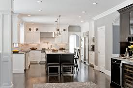 white cabinets dark floors. area rug with baseboards and dark flooring footed cabinets pendant lighting plus range hood white also wood trim picture of small floors