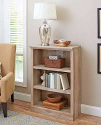 small bookshelf vertical mini wooden wall book storage unit weathered oak betterhomesandgardens traditional diy pipe shelves