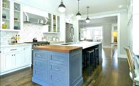 narrow kitchen island with seating table chairs long a sink and storage islan