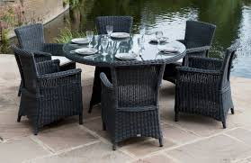 outdoor round patio table and chairs. outdoor dining room table furniture round black painted rattan with glass top combined six chairs for patio and