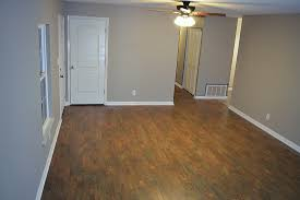 select surfaces barnwood laminate flooring rug pad for carpeted surfaces rugs home decorating