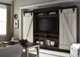 four piece morgan wall unit with sliding dual barn doors excellent condition left to right across wall 111 inches 76 inches tall fits up to 55 inches tv