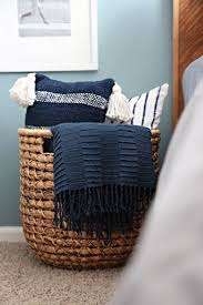A Wicker Catch All Adds A Rustic Touch To A Bedroom And Creates An Instant  Way To Store Pillows With Ease. If You Get One Thatu0027s Big Enough, ...
