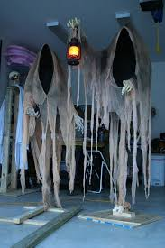 ideas outdoor halloween pinterest decorations: cloaked ghosts halloween yard decoration  cloaked ghosts halloween yard decoration
