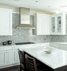 Modern, contemporary two-tone kitchen with crisp white kitchen cabinets,  espresso stained kitchen island, marble countertops and blue & brown glass  mosaic ...