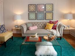 living room area rugs black standing lamp brown varnishing wooden table small round glass table orange