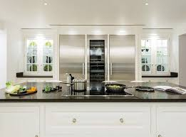 best kitchen lighting ideas. this elegant white painted kitchen is the epitome of sophistication with a sweeping natural stone floor allowing light to bounce off hand best lighting ideas f