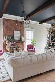 vintage living room black ceiling brick fireplace dark wood beams anthropologie home tufted sofa 2 of 23