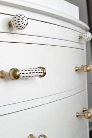 White drawer pulls Kitchen Cabinet Pottery Barn Hardwaredesign By Occasion Design By Occasion Pottery Barns Stassi Collection White Gold Hardware Design By