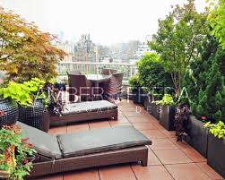 rooftop furniture. Image Of Roof Deck, Wicker Lounge Furniture, Dining Area, Planters With Lush Trees Rooftop Furniture O