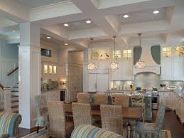 small coastal kitchen decor with white kitchen cabinet and small white granite countertop kitchen island