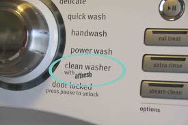 ... bleach or white vinegar to the detergent tray and run the machine on  its clean washer cycle. Most HE machines have a clean cycle or affresh  cycle
