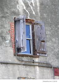architectural details antique half open wooden shutters brick wall