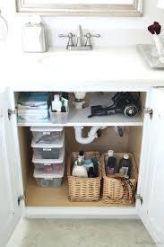 under kitchen sink storage solutions uk organizer ideas add shelf cut pipes cabinet use space